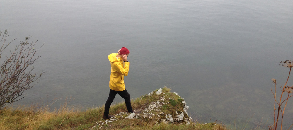 Red cap, yellow rain jacket.