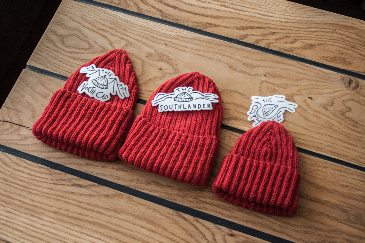 Three red beanies.