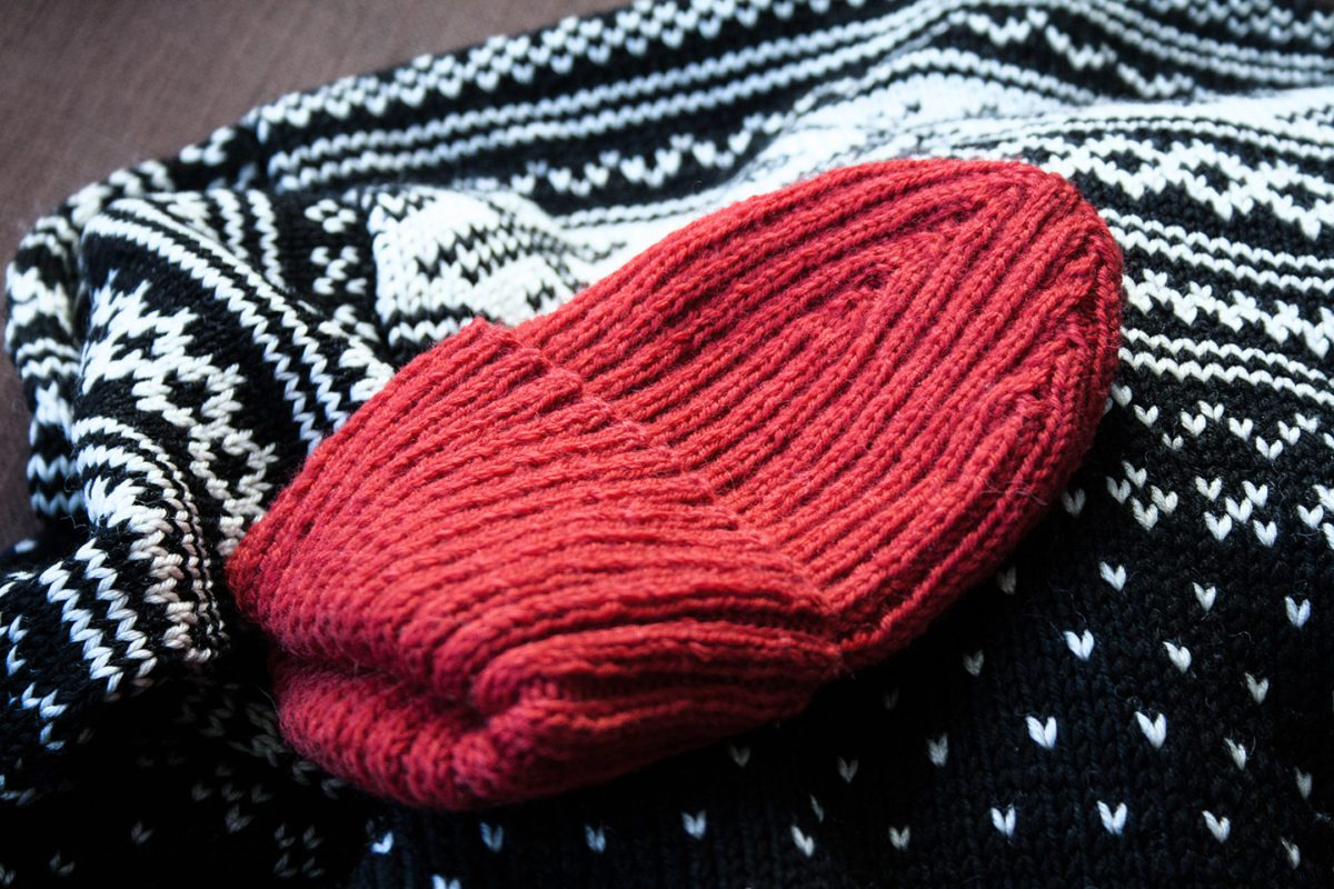 Red beanie on Norwegian traditional wool sweater.