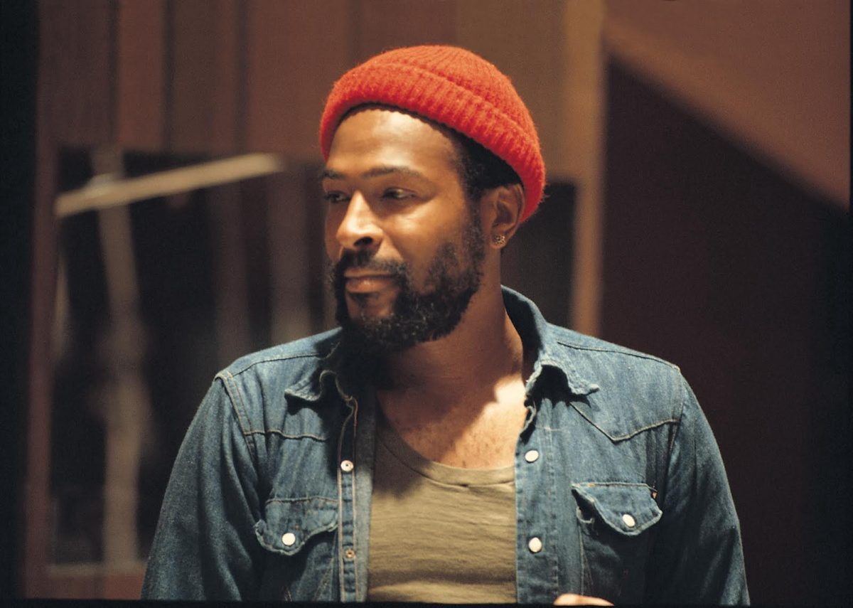 Marvin Gaye with red cap and blue denim shirt