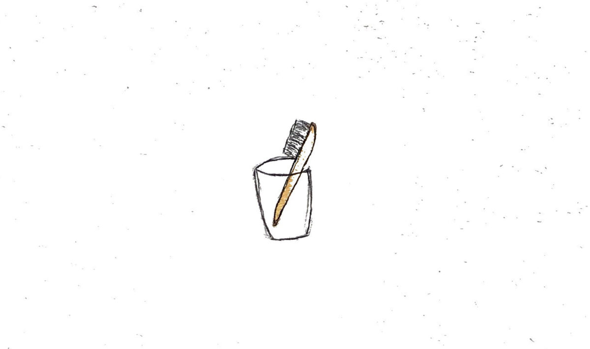 A minimalist drawing of a toothbrush.