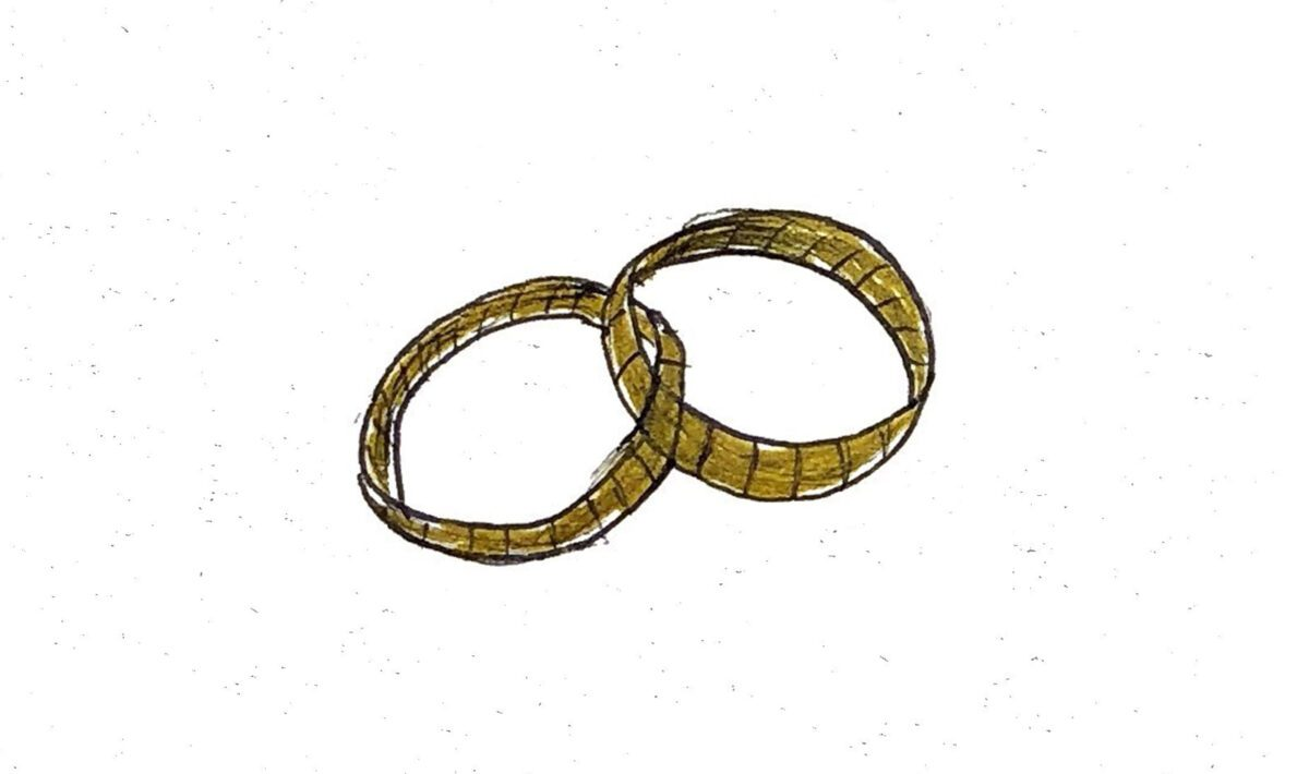 A minimalist drawing of a pair of wedding rings.