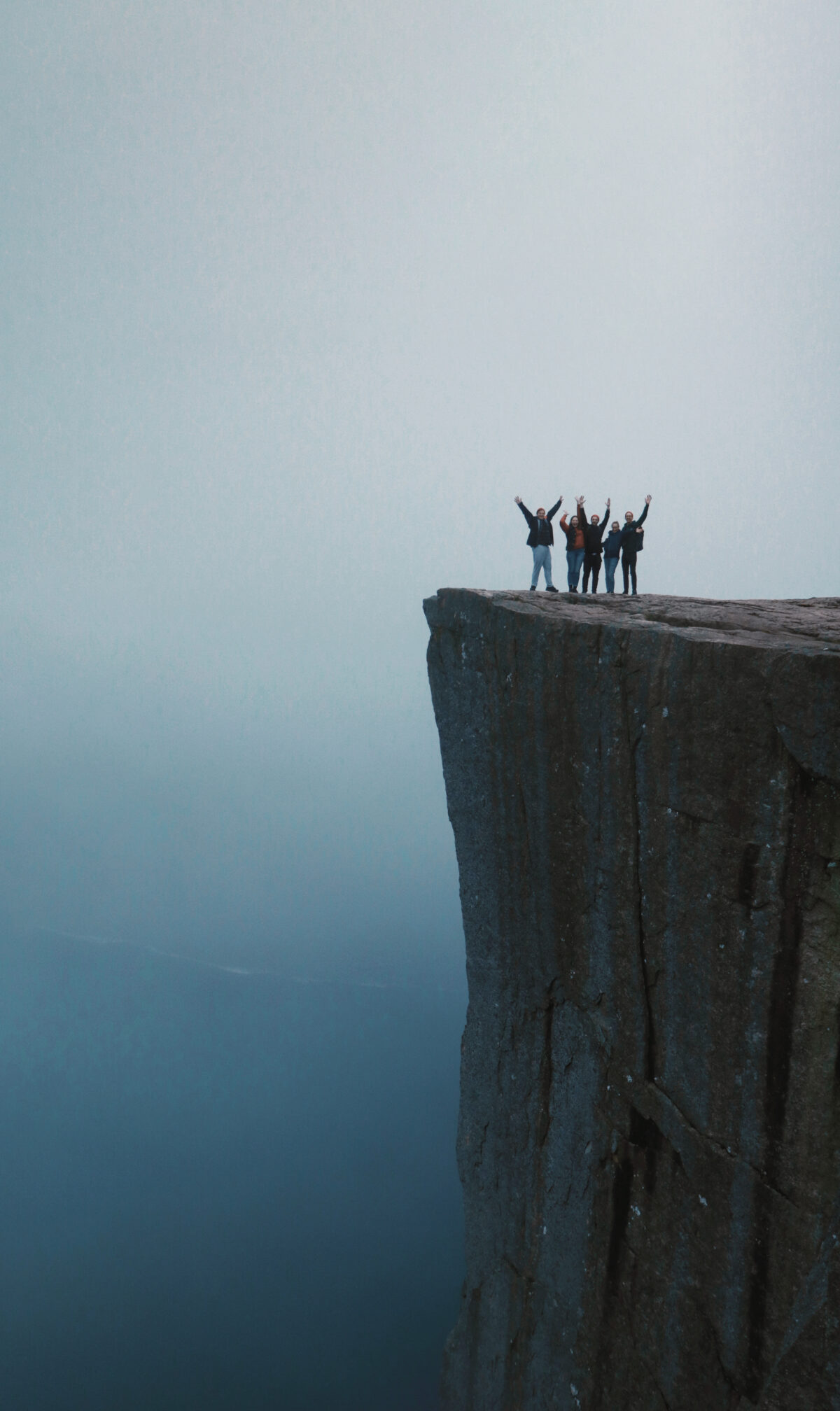 Group of people standing on the Pulpit Rock / Preikestolen