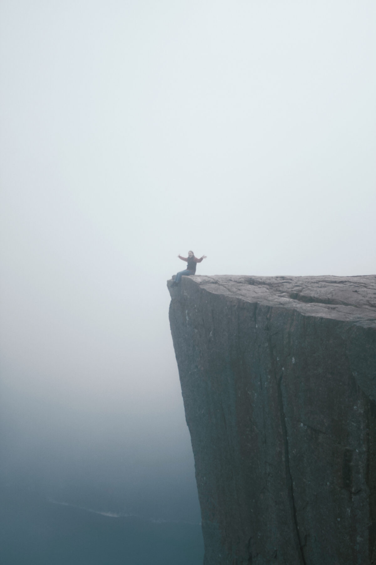 Sitting on the edge of the Pulpit Rock